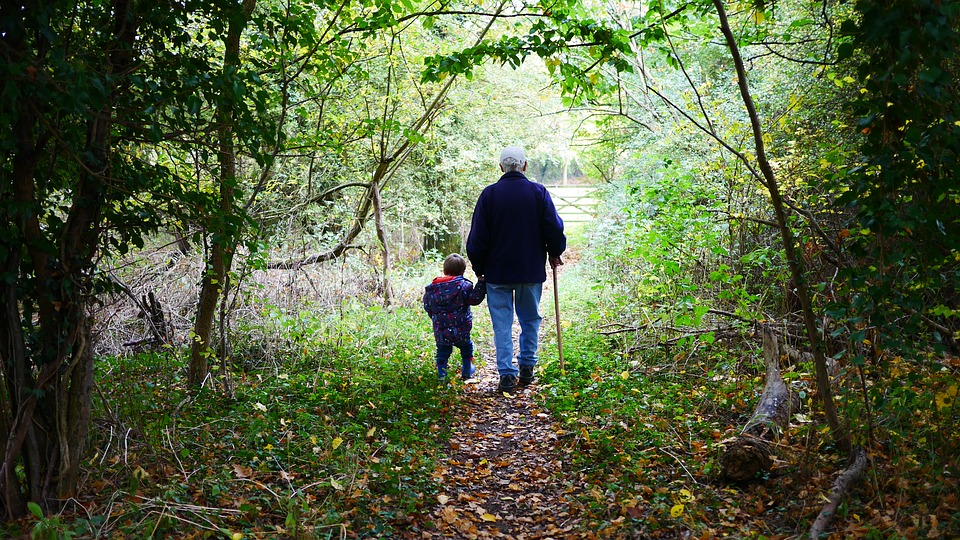 granddad walking with grandchild