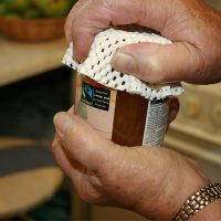 hands opening a jar with twister grip