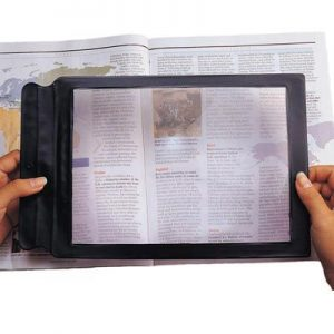 sheet magnifier used to help read a magazine
