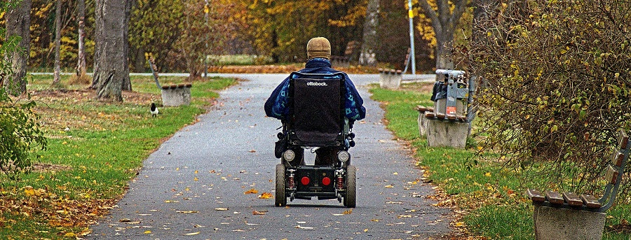 man on electric wheelchair in the park