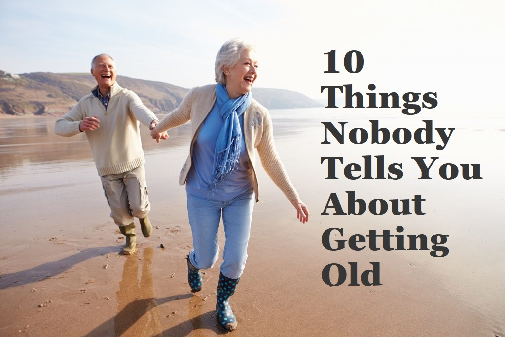 old couple running and laughing on the beach
