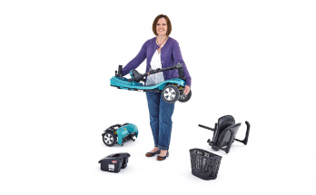 woman carrying a light mobility scooter