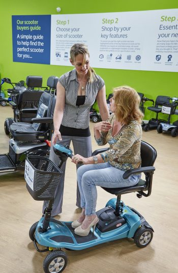 Natasha OT showing a customer a mobility scooter