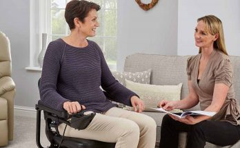 OT explaining a powerchair