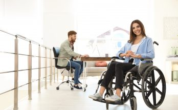 woman in a wheelchair in open plan office