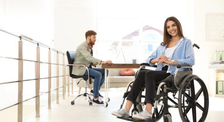 woman in a wheelchair in open plan office