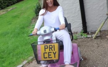 Katie Price sitting on her pink mobility scooter
