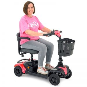woman riding a pink mobility scooter