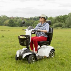 Vega RS8 mobility scooter in a park with long grass