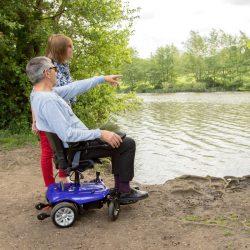 man using powerchair by a lake