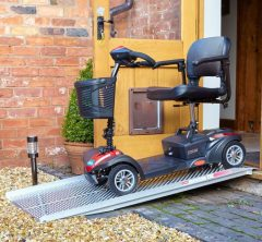 lightweight tramp from doorway with mobility scooter on it