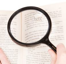 magnifying glass used to read a book