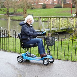 woman riding the aluminium mobility scooter in a park