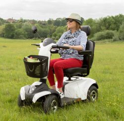 mobility scooter driving on long grass