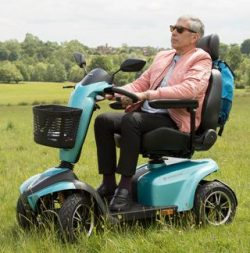 teal blue mobility scooter in the park