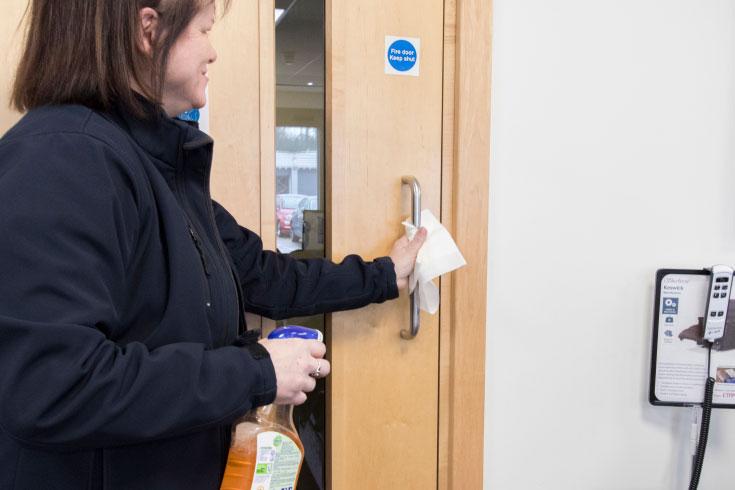 Gill cleaning door handles to stop the spread of coronavirus