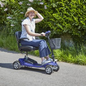 woman riding a compact mobility scooter