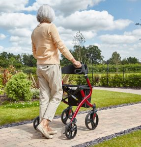 woman going out with a zimmer frame